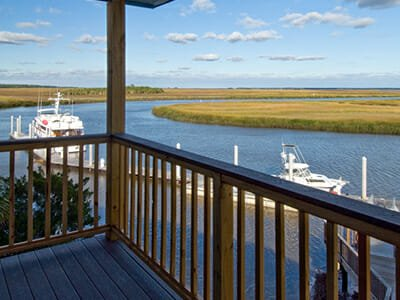 Patio, marina boats and marsh at Hidden Harbor Yacht Club and Residences in Brunswick, Georgia