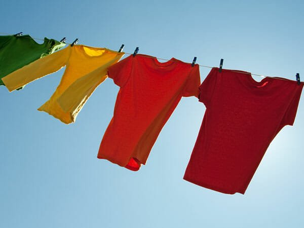 Line-drying clothes will help keep you and your house cool.