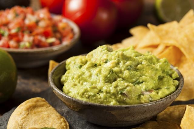 Green Homemade Guacamole with Tortilla ChipsGreen Homemade Guacamole with Tortilla Chips