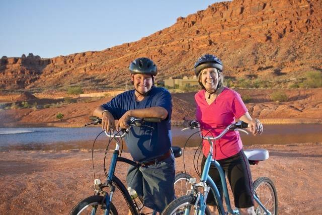 Active Senior Couple enjoying a bike ride together