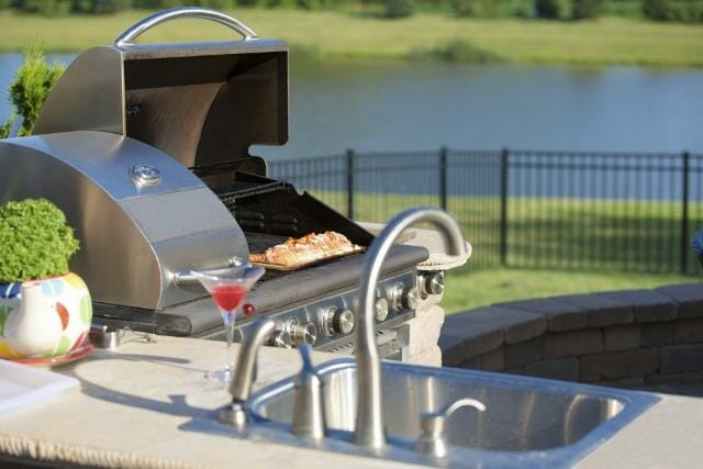Cooking Cedar Salmon on the Barbecue at the Outdoor Kitchen