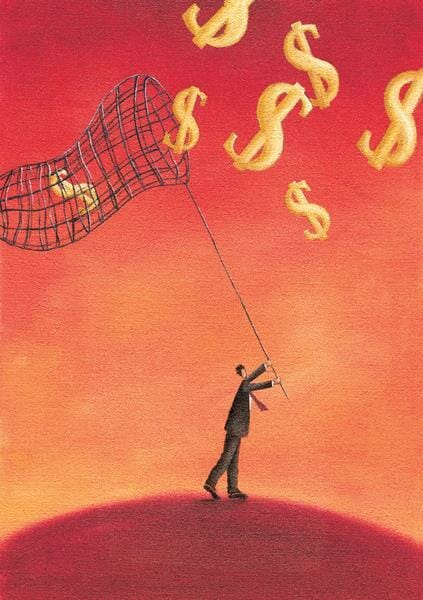 Businessman trying to catch money in a net