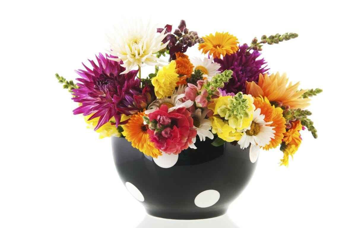 Colorful bouquet garden flowers in black vase