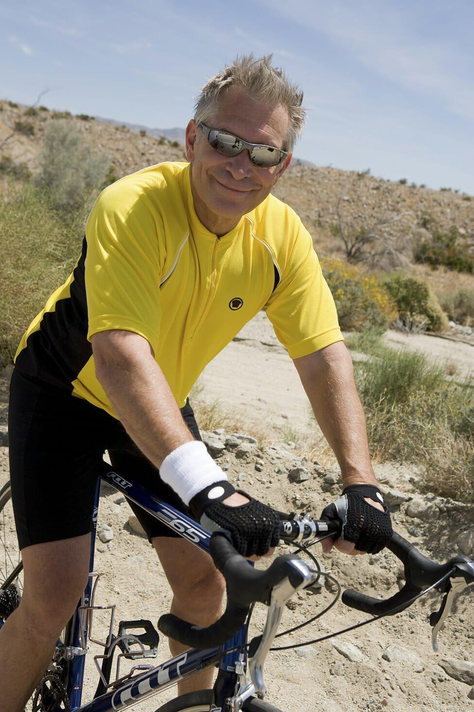 Senior man riding bike
