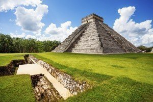 Monument of Chichen Itza on the green grass during summer in Mexico