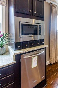 Del Webb has lowered the microwave and raised the dishwasher for greater convenience.