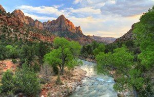 HDR image of the last rays of sun hitting The Watchman with the Virgin River in the foreground in ZIon National Park, Utah