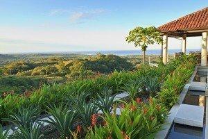 Villa tropical garden and coconut tree overlooking Tamarindo and Pacific Ocean in Guanacaste, Costa Rica