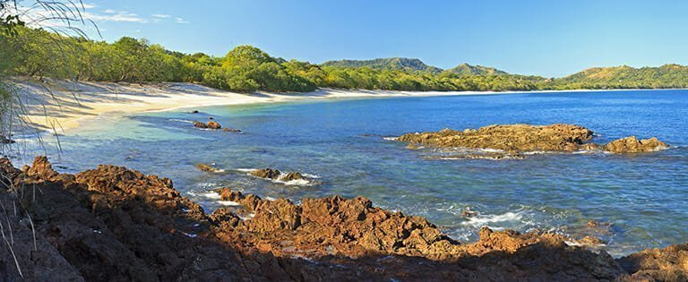 Panorama of quiet, beautiful Playa Conchal and the azure waters of the Pacific Ocean in Guanacaste, Costa RIca
