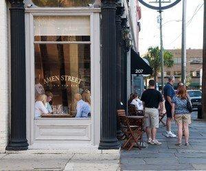 People at Amen Street Fish & Rawbar restaurant on East Bay Street in Charleston, SC