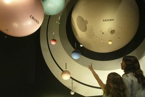 WASHINGTON - AUGUST 5: Two children look at a model of the Solar System at the Smithsonian National Air and Space Museum August 5, 2002 at the museum in Washington, DC. With hundreds of artifacts on display, the museum is one of the most visited sites in Washington. (Photo by Alex Wong/Getty Images)